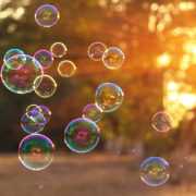 soap bubbles into the sunset with beautiful bokeh.close-up